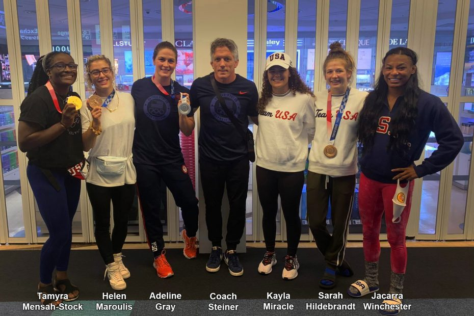 Coach Steiner and team with Olympic medals